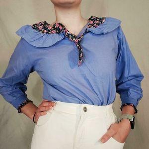 Vintage prairie style ruffled blue blouse.